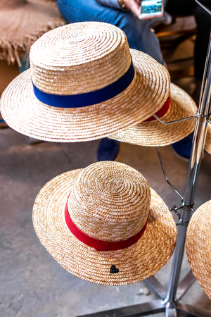 Straw hats shop. Straw hats on a spring festival market. Stock Photo