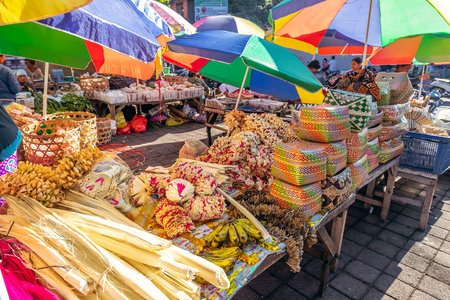 Traditional balinese handmade offering to gods on a morning market in Ubud. Bali island. Indonesia. Stock Photo