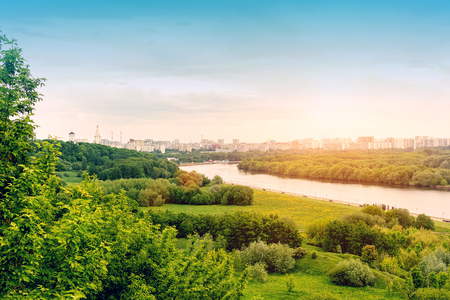 Amazing spring cityscape, green background, city river, Moscow.