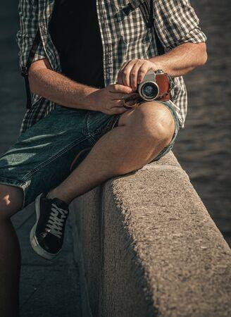 Man holding retro camera. Vintage camera. Fashion Photographer.