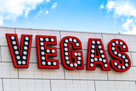 Vegas letters on the building. Blue sky. Vegas signboard.