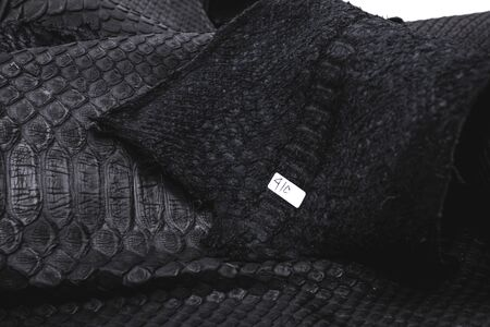 Real black snakeskin python leather. Snakeskin background.