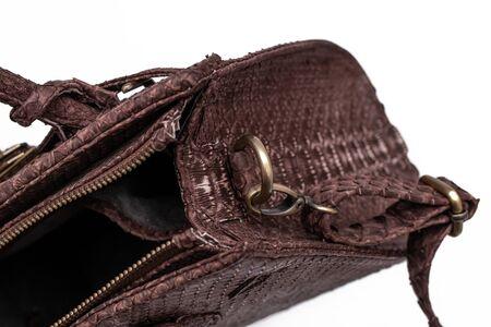 Fashion luxury snakeskin python bag isolated on a white background.