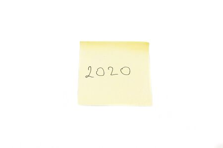 2020 yellow sticker isolated on a white background. New year. Standard-Bild