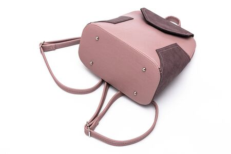 Fashion women leather pink backpack isolated on a white background. Zdjęcie Seryjne