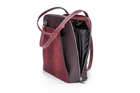 Fashion women leather dark red backpack isolated on a white background. Zdjęcie Seryjne