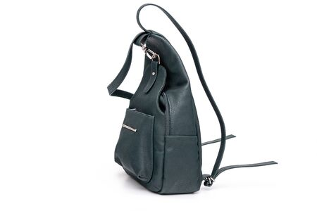 Fashion women leather green backpack isolated on a white background.