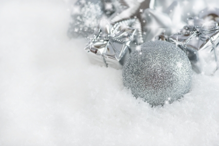 christmas greeting card silver christmas decorations in snow with sparkles copy space stock photo