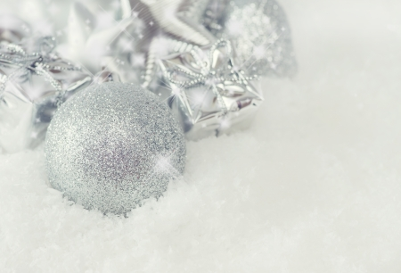 Christmas greeting card. silver christmas decorations in snow