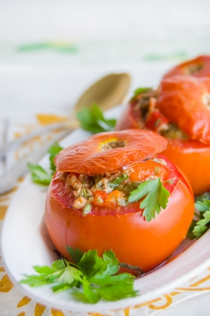 Baked tomatoes stuffed with tuna and vegetables, closeup Stock Photo - 17149978