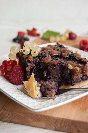 Cake with blueberries and frangipane, garnished with fruits, selective focus photo