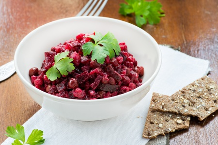 Salad with beetroot, potatoes, pickled cucumber and green peas (Russian beet salad- Vinegret) photo