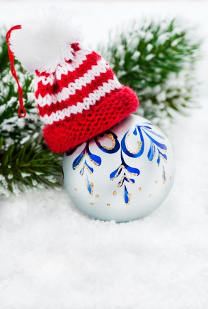 Christmas card with copy space - Christmas ball and hat on white background, selective focus photo