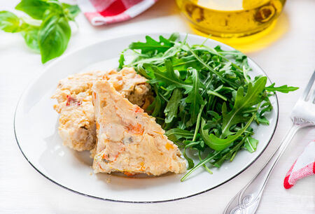 roquette: Chicken casserole with vegetables  served with green salad, selective focus