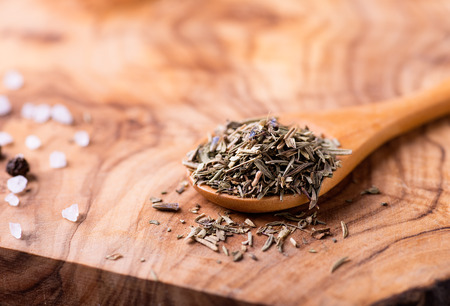 herbs de provence: Herbs de Provence. Mixed dried herbs in spoon over wooden background, selective focus