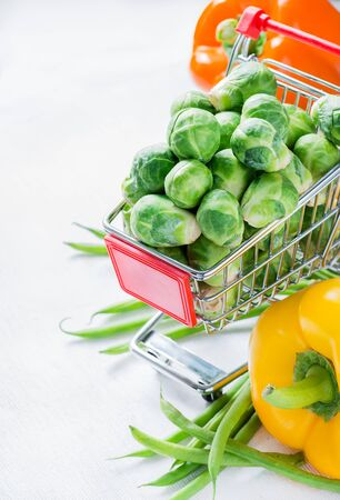 brussel: Fresh vegetables. Brussel sprouts, bell peppers and corn, selective focus