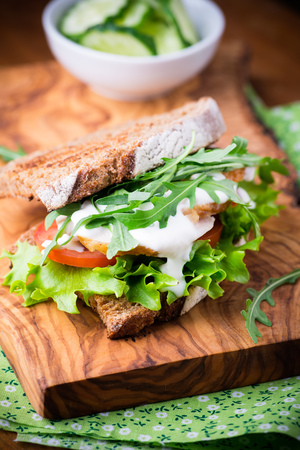 sandwiche: Rye toast sandwich with green leaf, tomato and chicken, selective focus Stock Photo