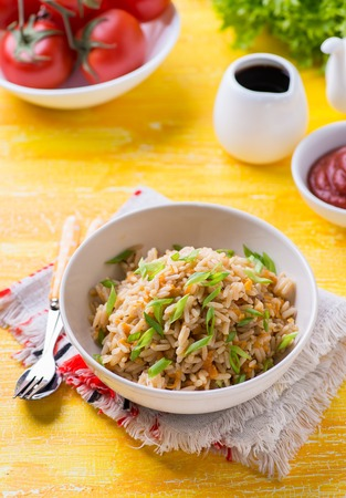sauces: Fried rice with vegetables and green onion, fresh tomatoes and sauces