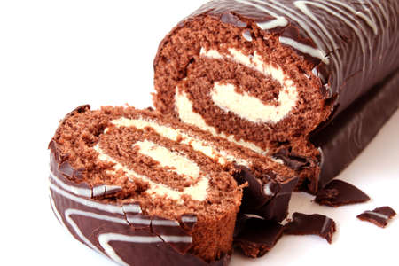 roll: chocolate Swiss roll on white Stock Photo