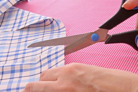 Dressmaker cuts scissors fabrics Stock Photo - 6196924