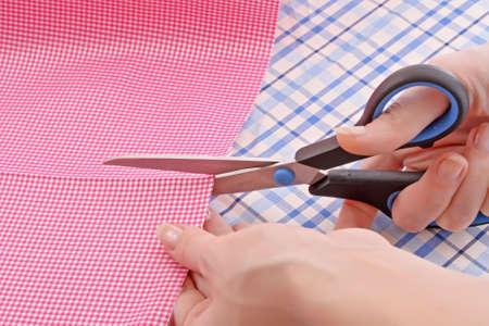 Dressmaker cuts scissors fabrics Stock Photo - 6197225