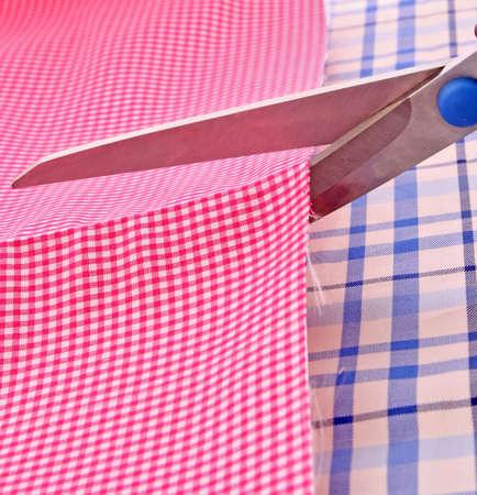 Dressmaker cuts by scissors fabrics Stock Photo - 6197440