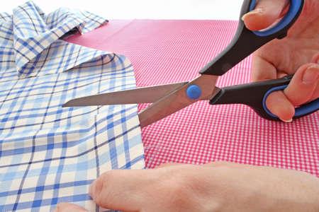 Dressmaker cuts scissors fabrics Stock Photo - 6197351