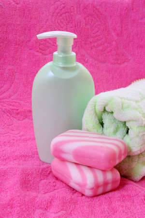 soap, flower and  towel on pink photo