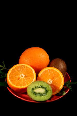 Sliced orange on black background photo