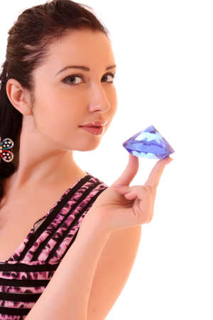 Young  woman with big blue  diamond on white photo