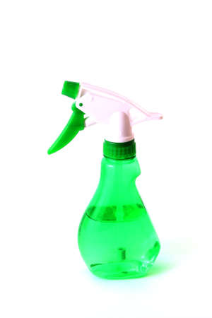 ejector: Green spray bottle isolated on white background