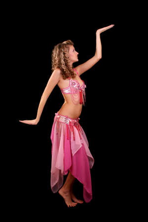 Belly dancer isolated on a  black background photo