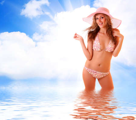 beautiful young woman in bikini on the sky and water background Stock Photo - 6271048