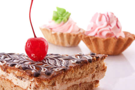 sweet cake with cherry isolated on white photo