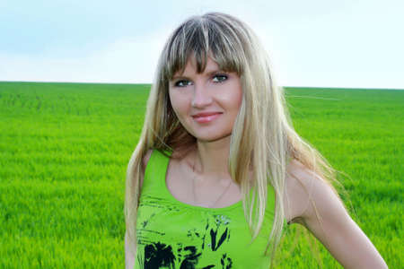 girl siting on the grass in the field photo