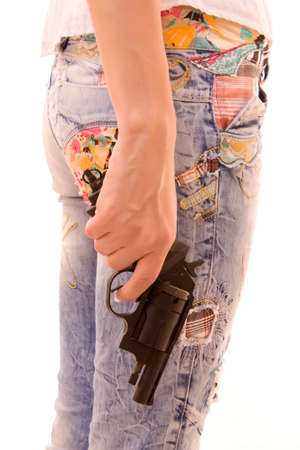 Woman ass and pistol in hands isolated on white photo