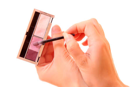 Set of four colors for makeup in the hands  on white photo