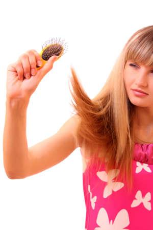 Beautiful young woman combing her hair Stock Photo - 6282297