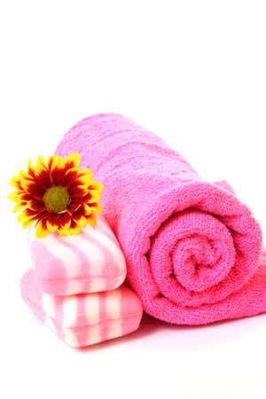 soap, flower and towel on white photo