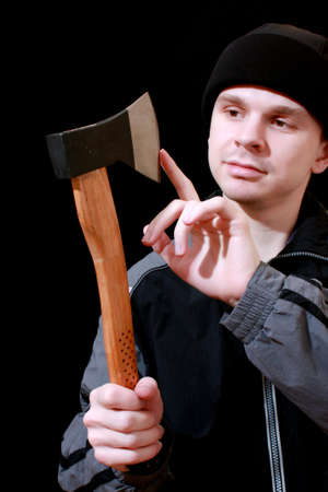 man with axe on black background Stock Photo - 12329792