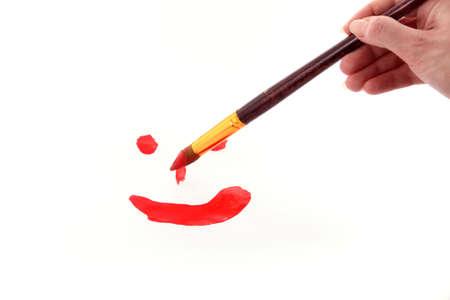 brush paints smile on paper photo