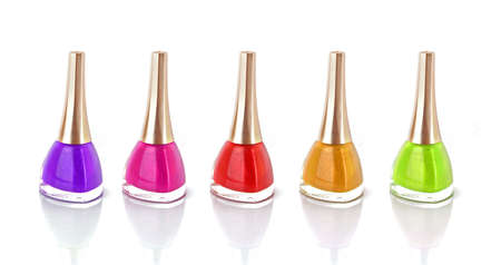 Group of nail polishes of different colors on white background photo