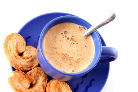 Cup of coffee with milk and cookies isolated over white background photo