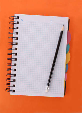 Notebook with pencil on the orange background Stock Photo - 6333602