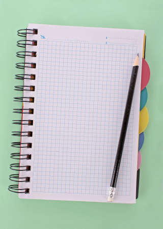 Notebook with pencil on the green background Stock Photo - 6333397