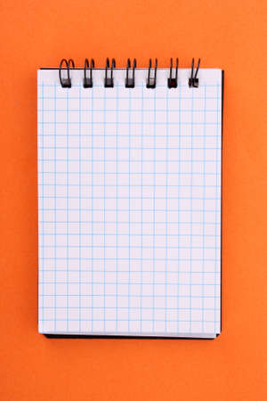 Notebook on the orange background Stock Photo - 6333252
