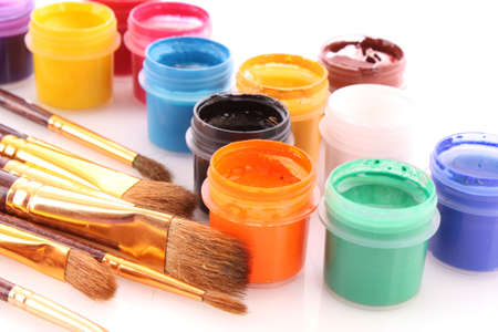 Opened paint buckets colors with paintbrush Stock Photo - 6333550