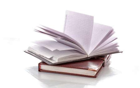 Leather notebooks on white background photo