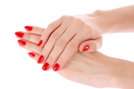 Two hands with the red manicure, isolated Stock Photo - 6333154