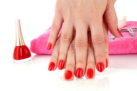 Two hands with the red manicure, isolated Stock Photo - 6333401